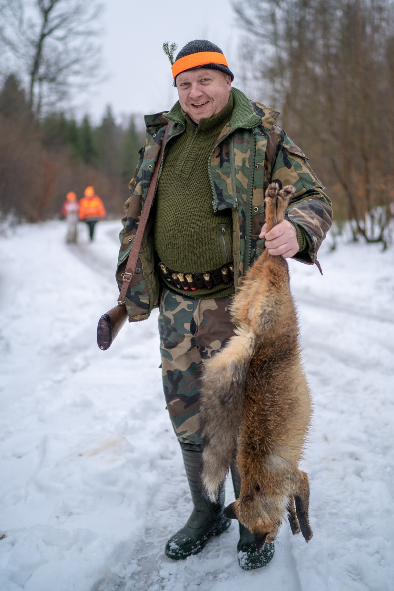 hunter with a fox
